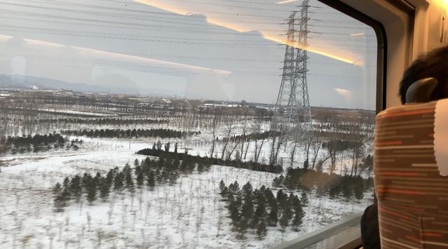 特寫:新春踏雪行 坐上京張高鐵看脫貧